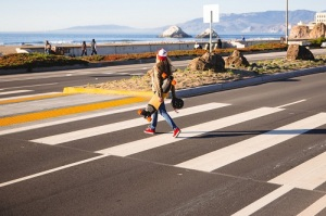Lightweight and Portable E-Skateboard - The woman was able to carry